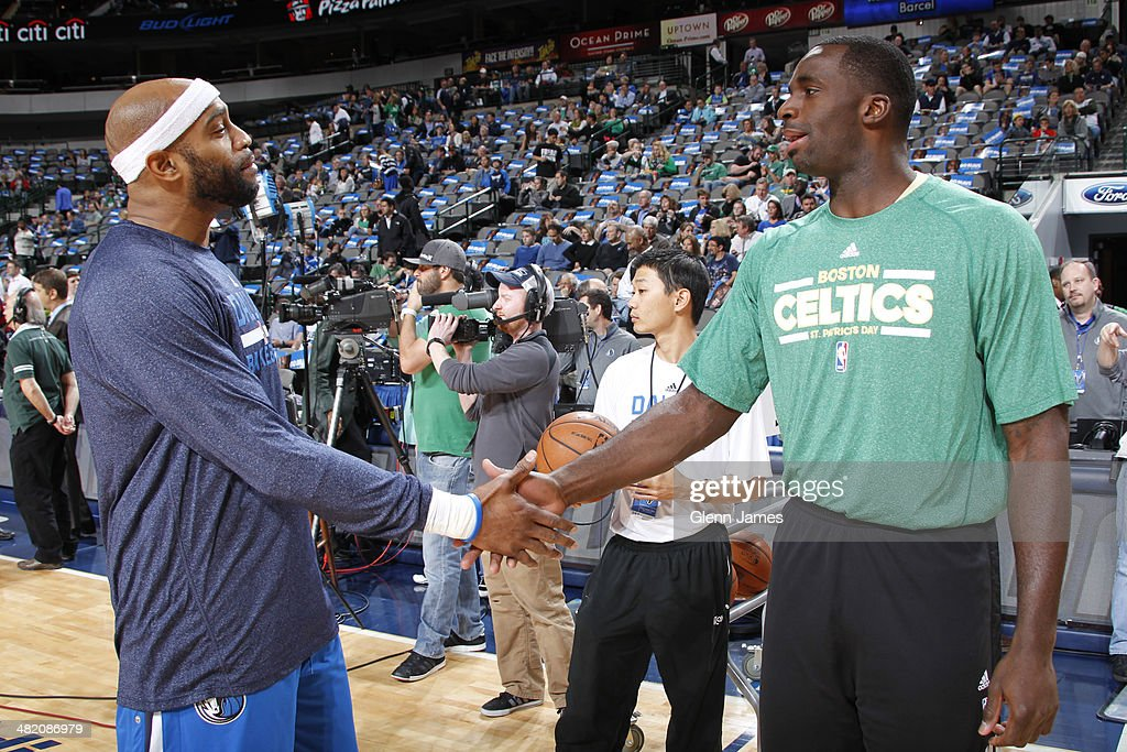 <a gi-track='captionPersonalityLinkClicked' href=/galleries/search?phrase=Vince+Carter&family=editorial&specificpeople=201488 ng-click='$event.stopPropagation()'>Vince Carter</a> #25 of the Dallas Mavericks and <a gi-track='captionPersonalityLinkClicked' href=/galleries/search?phrase=Brandon+Bass&family=editorial&specificpeople=233806 ng-click='$event.stopPropagation()'>Brandon Bass</a> #30 of the Boston Celtics talk before the game on March 17, 2014 at the American Airlines Center in Dallas, Texas.