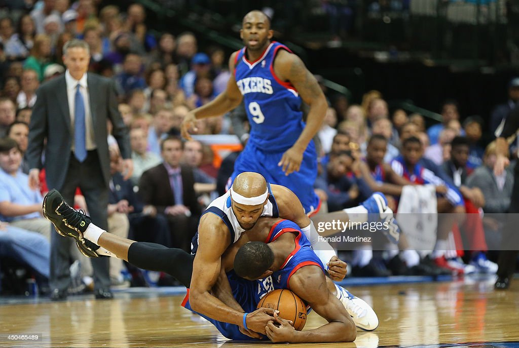 <a gi-track='captionPersonalityLinkClicked' href=/galleries/search?phrase=Vince+Carter&family=editorial&specificpeople=201488 ng-click='$event.stopPropagation()'>Vince Carter</a> #25 of the Dallas Mavericks and <a gi-track='captionPersonalityLinkClicked' href=/galleries/search?phrase=Thaddeus+Young&family=editorial&specificpeople=3847270 ng-click='$event.stopPropagation()'>Thaddeus Young</a> #21 of the Philadelphia 76ers hold on to the ball on a jump ball call at American Airlines Center on November 18, 2013 in Dallas, Texas.
