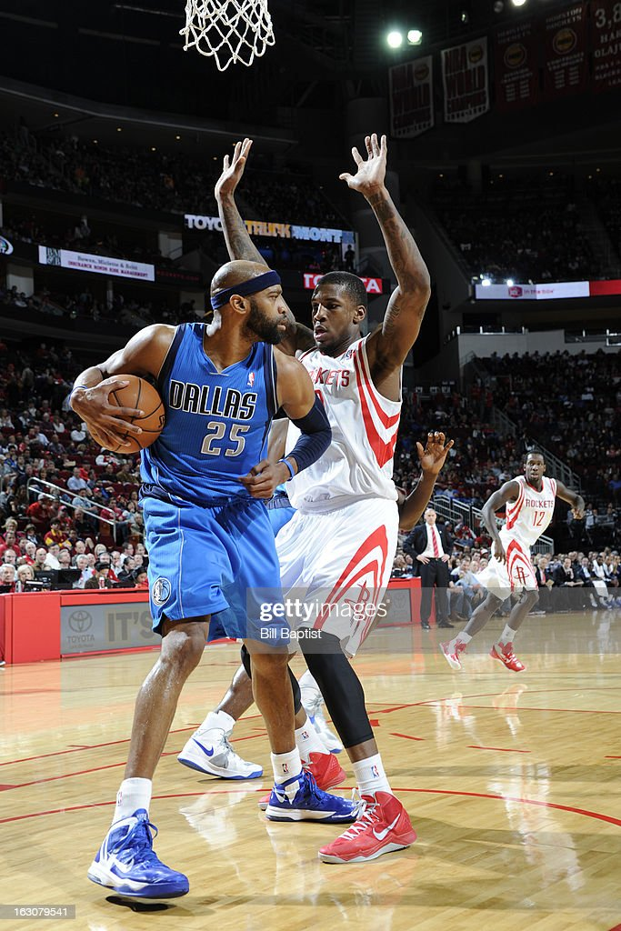<a gi-track='captionPersonalityLinkClicked' href=/galleries/search?phrase=Vince+Carter&family=editorial&specificpeople=201488 ng-click='$event.stopPropagation()'>Vince Carter</a> #25 of the Dallas Mavericks attempts to move the ball against the defense of Thomas Robinson #0 of the Houston Rockets on March 3, 2013 at the Toyota Center in Houston, Texas.