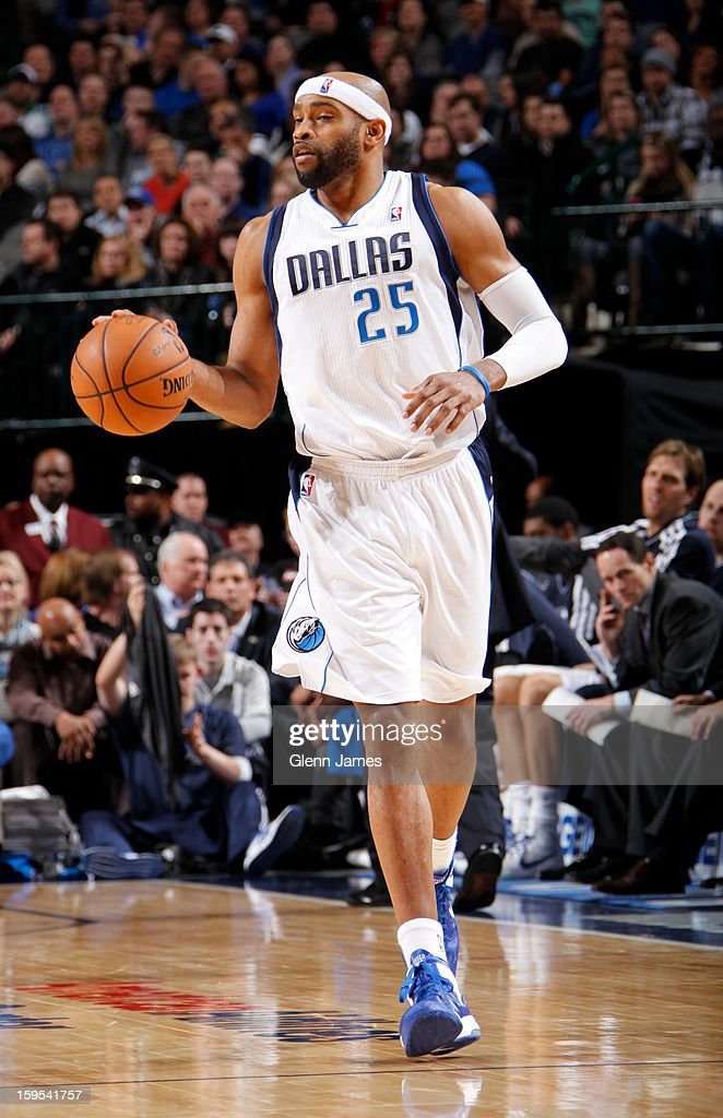 <a gi-track='captionPersonalityLinkClicked' href=/galleries/search?phrase=Vince+Carter&family=editorial&specificpeople=201488 ng-click='$event.stopPropagation()'>Vince Carter</a> #25 of the Dallas Mavericks brings the ball up the court against the Minnesota Timberwolves on January 14, 2013 at the American Airlines Center in Dallas, Texas.