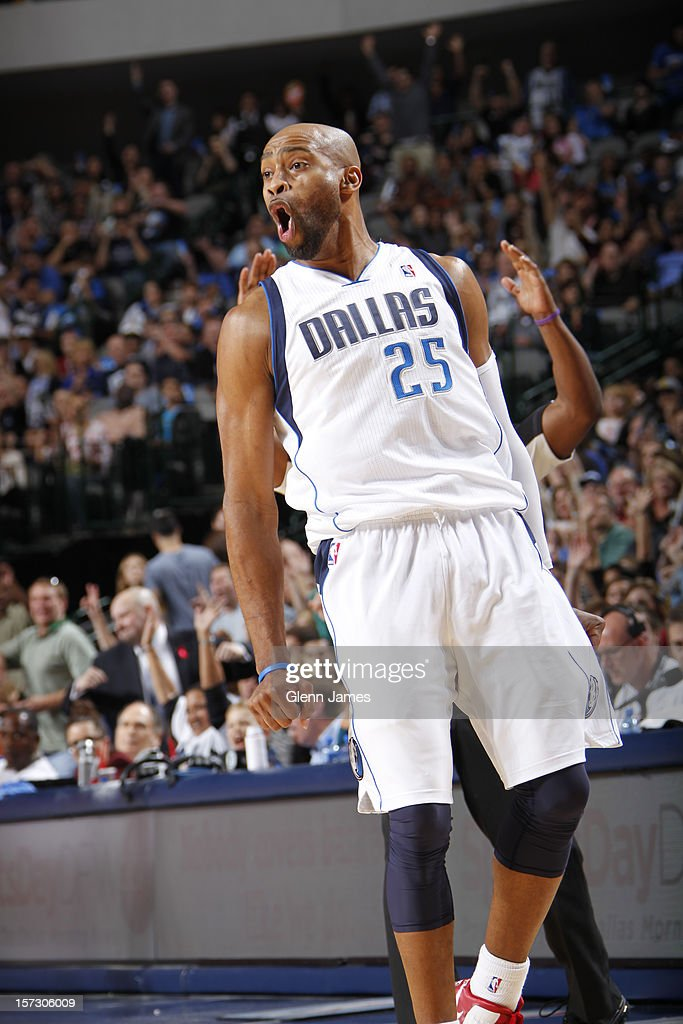 <a gi-track='captionPersonalityLinkClicked' href=/galleries/search?phrase=Vince+Carter&family=editorial&specificpeople=201488 ng-click='$event.stopPropagation()'>Vince Carter</a> #25 of the Dallas Mavericks celebrates hitting a jumper against the Detroit Pistons on December 1, 2012 at the American Airlines Center in Dallas, Texas.