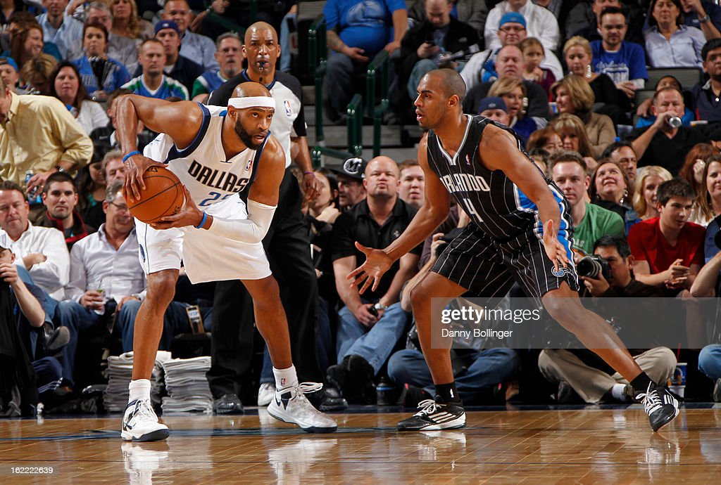 Vince Carter #25 of the Dallas Mavericks controls the ball against Arron Afflalo #4 of the Orlando Magic on February 20, 2013 at the American Airlines Center in Dallas, Texas.