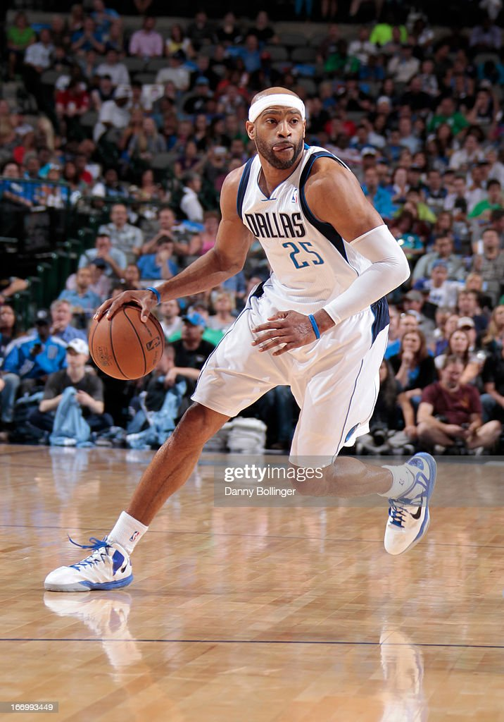 <a gi-track='captionPersonalityLinkClicked' href=/galleries/search?phrase=Vince+Carter&family=editorial&specificpeople=201488 ng-click='$event.stopPropagation()'>Vince Carter</a> #25 of the Dallas Mavericks dribbles against the Memphis Grizzlies on April 15, 2013 at the American Airlines Center in Dallas, Texas.