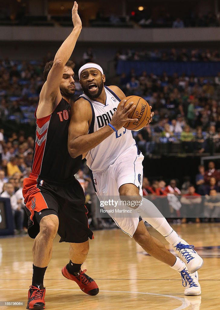 Vince Carter #25 of the Dallas Mavericks dribbles the ball against Jose Calderon #8 of the Toronto Raptors at American Airlines Center on November 7, 2012 in Dallas, Texas.