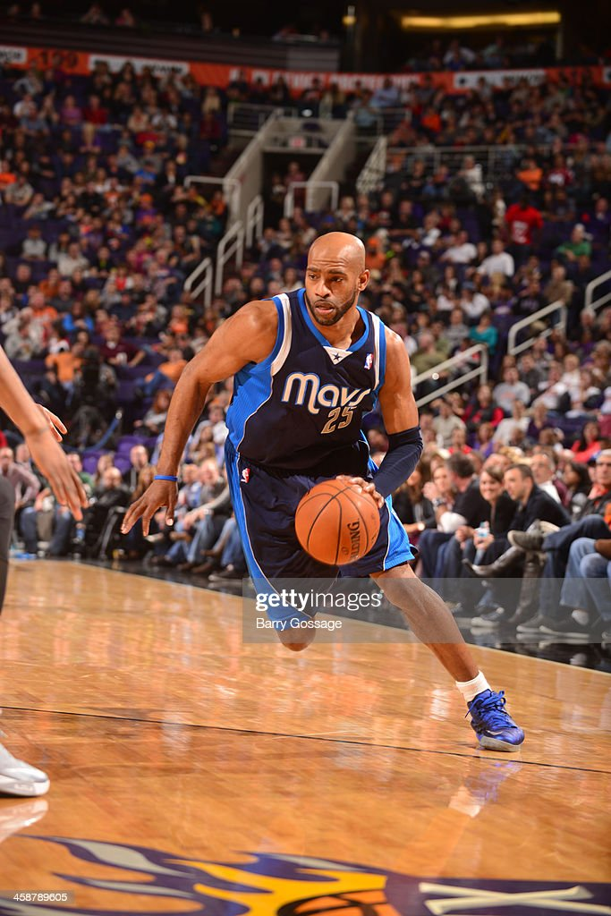 <a gi-track='captionPersonalityLinkClicked' href=/galleries/search?phrase=Vince+Carter&family=editorial&specificpeople=201488 ng-click='$event.stopPropagation()'>Vince Carter</a> #25 of the Dallas Mavericks drives against the Phoenix Suns on December 21, 2013 at U.S. Airways Center in Phoenix, Arizona.