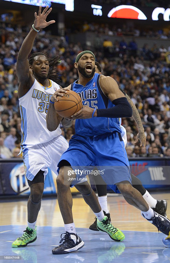 Vince Carter (25) of the Dallas Mavericks drives past Kenneth Faried (35) of the Denver Nuggets during the fourth quarter April 4, 2013 at Pepsi Center.