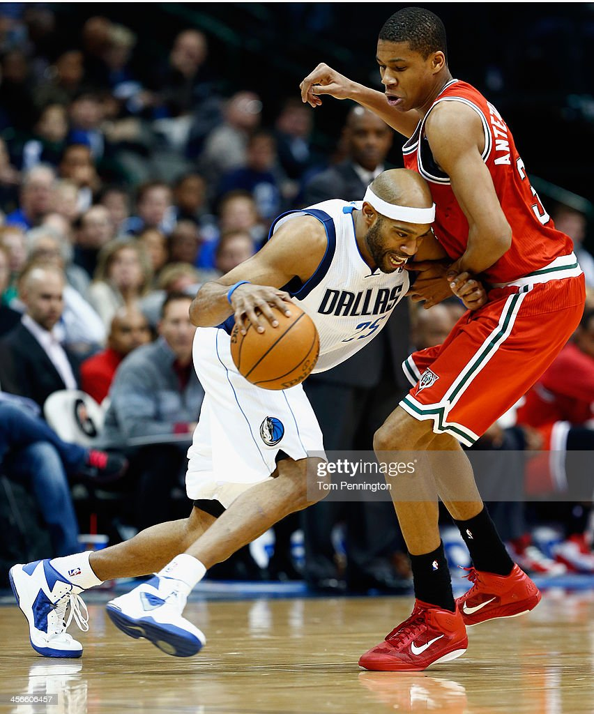 Vince Carter #25 of the Dallas Mavericks drives the ball against Giannis Antetokounmpo #34 of the Milwaukee Bucks in the fourth quarter at American Airlines Center on December 14, 2013 in Dallas, Texas.