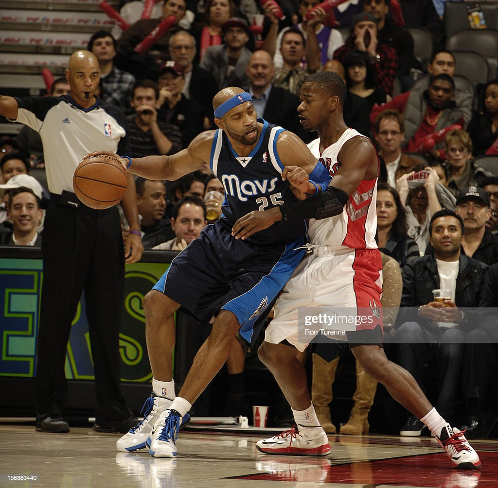 Vince Carter #25 of the Dallas Mavericks drives to the basket against the Toronto Raptors on December 14, 2012 at the Air Canada Centre in Toronto, Ontario, Canada.