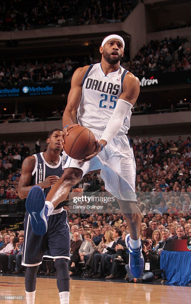 Vince Carter #25 of the Dallas Mavericks drives to the basket against the Oklahoma City Thunder on January 18, 2013 at the American Airlines Center in Dallas, Texas.