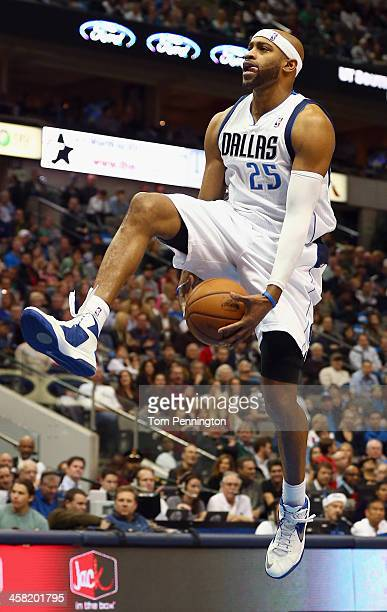 Vince Carter of the Dallas Mavericks drives to the basket against the Toronto Raptors at American Airlines Center on December 20 2013 in Dallas Texas...