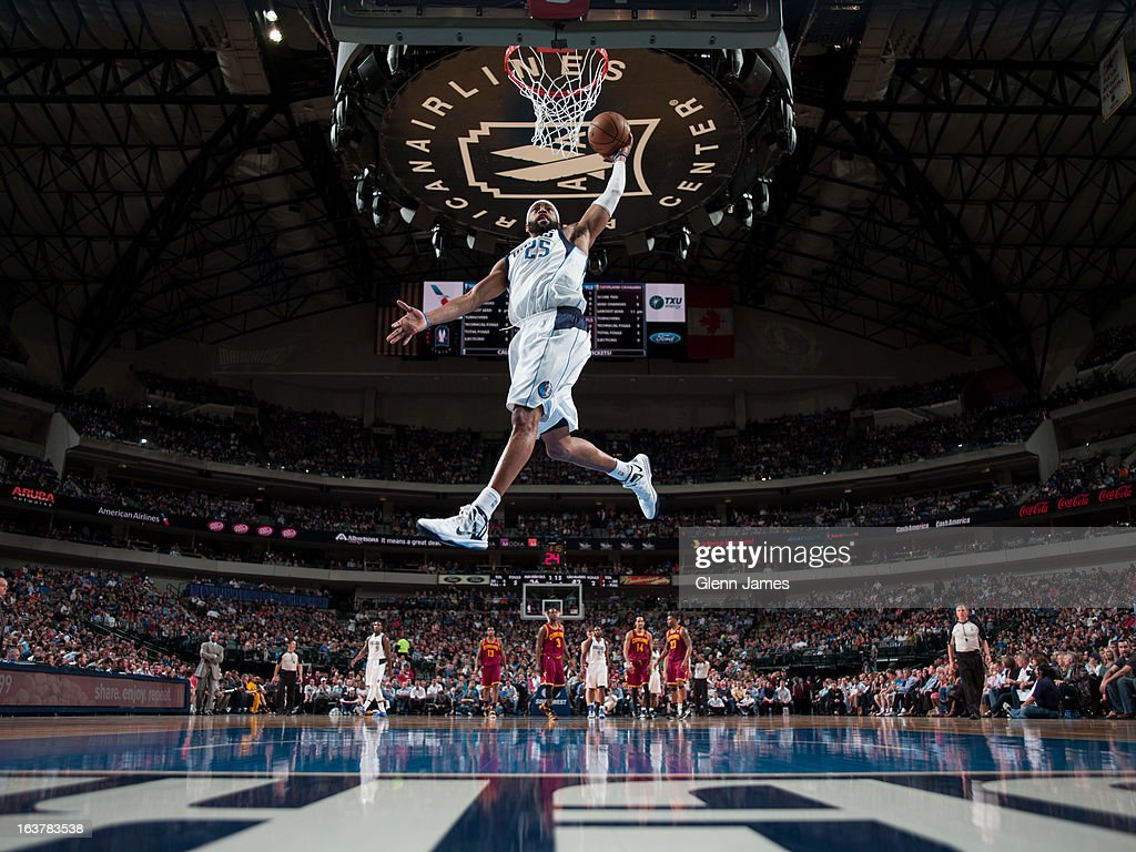 Vince Carter of the Dallas Mavericks dunks on a fast break against the Cleveland Cavaliers on March 15 2013 at the American Airlines Center in Dallas...