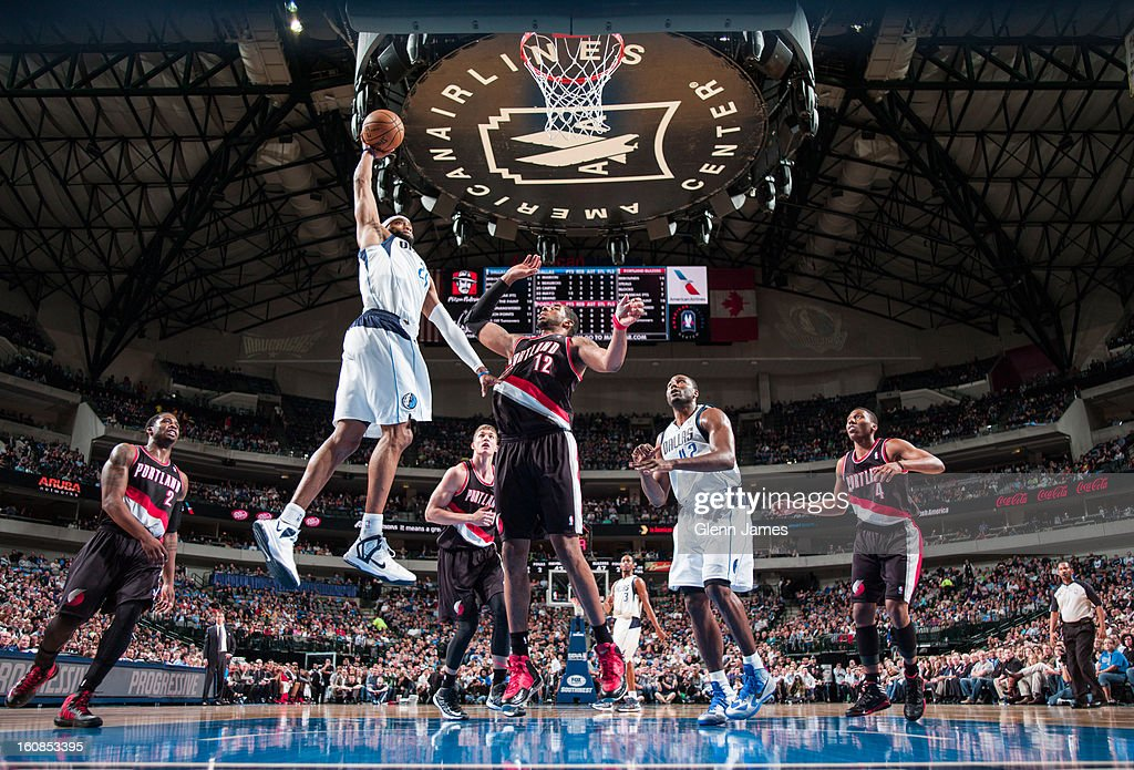 <a gi-track='captionPersonalityLinkClicked' href=/galleries/search?phrase=Vince+Carter&family=editorial&specificpeople=201488 ng-click='$event.stopPropagation()'>Vince Carter</a> #25 of the Dallas Mavericks flies in for the dunk against <a gi-track='captionPersonalityLinkClicked' href=/galleries/search?phrase=LaMarcus+Aldridge&family=editorial&specificpeople=453277 ng-click='$event.stopPropagation()'>LaMarcus Aldridge</a> #12 of the Portland Trail Blazers on February 6, 2013 at the American Airlines Center in Dallas, Texas.