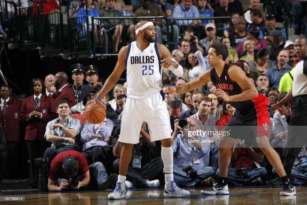 <a gi-track='captionPersonalityLinkClicked' href=/galleries/search?phrase=Vince+Carter&family=editorial&specificpeople=201488 ng-click='$event.stopPropagation()'>Vince Carter</a> #25 of the Dallas Mavericks gets ready to drive to the basket while guarded by <a gi-track='captionPersonalityLinkClicked' href=/galleries/search?phrase=Landry+Fields&family=editorial&specificpeople=4184645 ng-click='$event.stopPropagation()'>Landry Fields</a> #2 of the Toronto Raptors on November 7, 2012 at the American Airlines Center in Dallas, Texas.