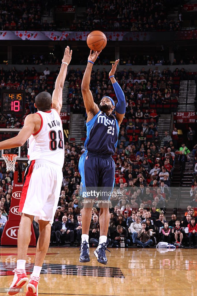 Vince Carter #25 of the Dallas Mavericks goes for a jump shot against Nicolas Batum #88 of the Portland Trail Blazers during the game between the Dallas Mavericks and the Portland Trail Blazers on January 29, 2013 at the Rose Garden Arena in Portland, Oregon.