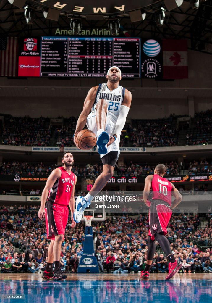 <a gi-track='captionPersonalityLinkClicked' href=/galleries/search?phrase=Vince+Carter&family=editorial&specificpeople=201488 ng-click='$event.stopPropagation()'>Vince Carter</a> #25 of the Dallas Mavericks goes in for the dunk against the Toronto Raptors on December 20, 2013 at the American Airlines Center in Dallas, Texas.