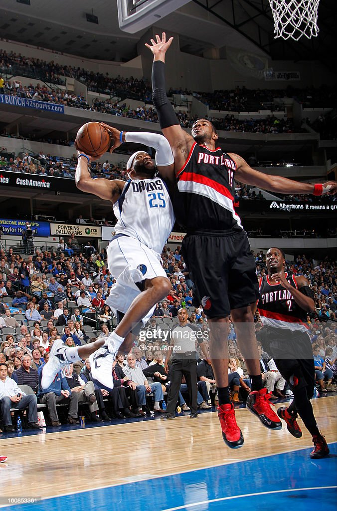 Vince Carter #25 of the Dallas Mavericks goes in for the layup against LaMarcus Aldridge #12 of the Portland Trail Blazers on February 6, 2013 at the American Airlines Center in Dallas, Texas.