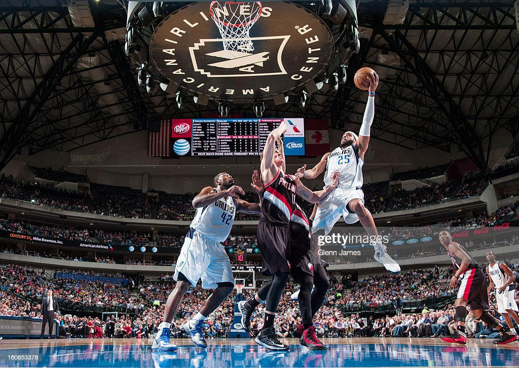 <a gi-track='captionPersonalityLinkClicked' href=/galleries/search?phrase=Vince+Carter&family=editorial&specificpeople=201488 ng-click='$event.stopPropagation()'>Vince Carter</a> #25 of the Dallas Mavericks goes in for the layup against <a gi-track='captionPersonalityLinkClicked' href=/galleries/search?phrase=Meyers+Leonard&family=editorial&specificpeople=6893999 ng-click='$event.stopPropagation()'>Meyers Leonard</a> #11 of the Portland Trail Blazers on February 6, 2013 at the American Airlines Center in Dallas, Texas.