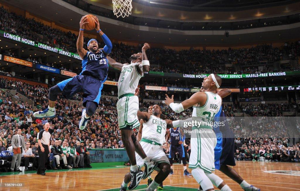 Vince Carter #25 of the Dallas Mavericks goes to the basket against Kevin Garnett #5 of the Boston Celtics during the game between the Boston Celtics and the Dallas Mavericks on December 12, 2012 at the TD Garden in Boston, Massachusetts.
