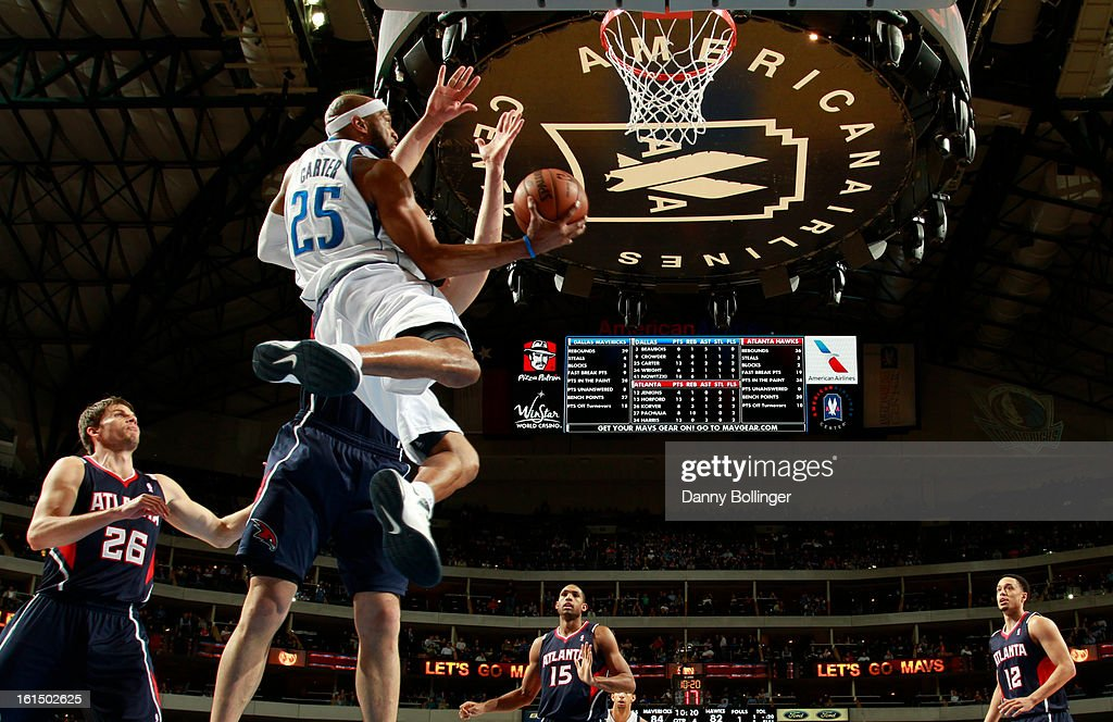 <a gi-track='captionPersonalityLinkClicked' href=/galleries/search?phrase=Vince+Carter&family=editorial&specificpeople=201488 ng-click='$event.stopPropagation()'>Vince Carter</a> #25 of the Dallas Mavericks goes to the basket against the Atlanta Hawks on February 11, 2013 at the American Airlines Center in Dallas, Texas.