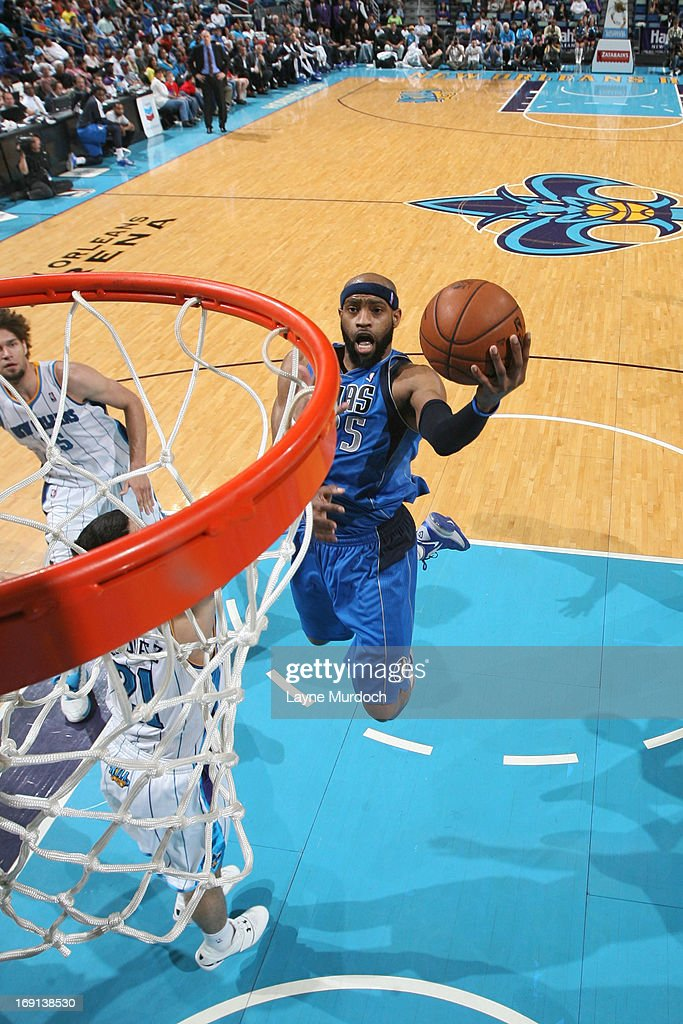 <a gi-track='captionPersonalityLinkClicked' href=/galleries/search?phrase=Vince+Carter&family=editorial&specificpeople=201488 ng-click='$event.stopPropagation()'>Vince Carter</a> #25 of the Dallas Mavericks goes to the basket against the New Orleans Hornets on April 14, 2013 at the New Orleans Arena in New Orleans, Louisiana.