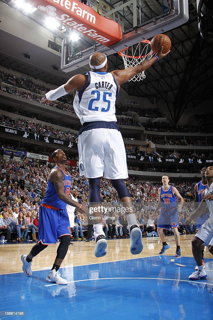 Vince Carter #25 of the Dallas Mavericks goes up and under for a shot against J.R. Smith #8 of the New York Knicks on November 21, 2012 at the American Airlines Center in Dallas, Texas.