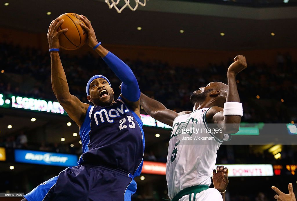 Vince Carter #25 of the Dallas Mavericks goes up to the basket for a layup in front of Kevin Garnett #5 of the Boston Celtics during the game on December 12, 2012 at TD Garden in Boston, Massachusetts.