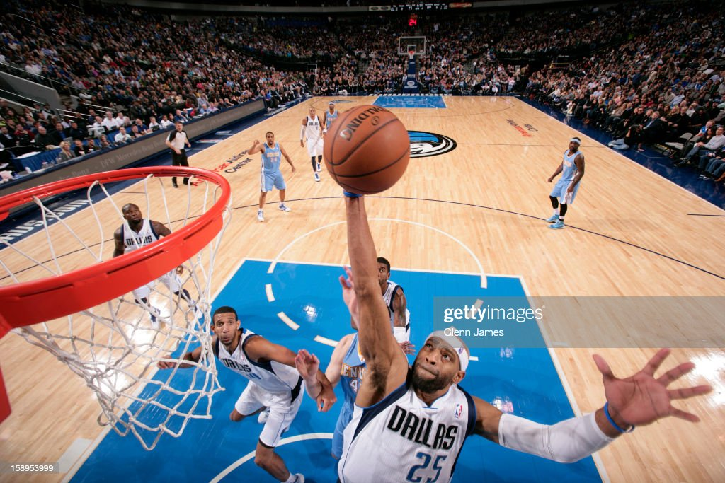 <a gi-track='captionPersonalityLinkClicked' href=/galleries/search?phrase=Vince+Carter&family=editorial&specificpeople=201488 ng-click='$event.stopPropagation()'>Vince Carter</a> #25 of the Dallas Mavericks grabs a rebound against the Denver Nuggets on December 28, 2012 at the American Airlines Center in Dallas, Texas.