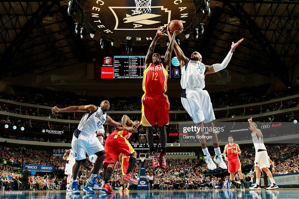 <a gi-track='captionPersonalityLinkClicked' href=/galleries/search?phrase=Vince+Carter&family=editorial&specificpeople=201488 ng-click='$event.stopPropagation()'>Vince Carter</a> #25 of the Dallas Mavericks grabs a rebound against the Houston Rockets on March 6, 2013 at the American Airlines Center in Dallas, Texas.