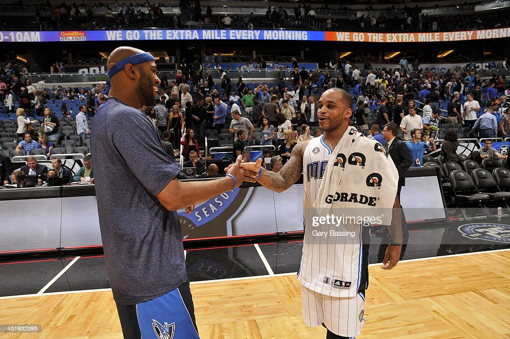 <a gi-track='captionPersonalityLinkClicked' href=/galleries/search?phrase=Vince+Carter&family=editorial&specificpeople=201488 ng-click='$event.stopPropagation()'>Vince Carter</a> #25 of the Dallas Mavericks greets <a gi-track='captionPersonalityLinkClicked' href=/galleries/search?phrase=Jameer+Nelson&family=editorial&specificpeople=202057 ng-click='$event.stopPropagation()'>Jameer Nelson</a> #14 of the Orlando Magic on November 16, 2013 at Amway Center in Orlando, Florida.