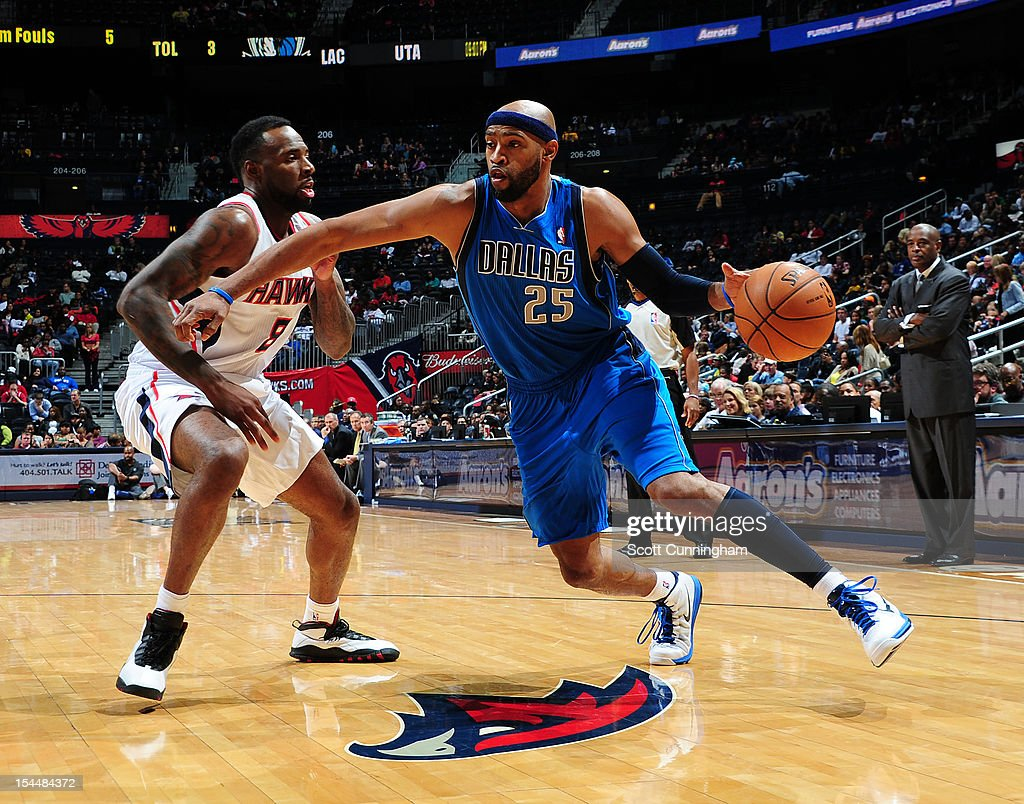 <a gi-track='captionPersonalityLinkClicked' href=/galleries/search?phrase=Vince+Carter&family=editorial&specificpeople=201488 ng-click='$event.stopPropagation()'>Vince Carter</a> #25 of the Dallas Mavericks handles the ball against <a gi-track='captionPersonalityLinkClicked' href=/galleries/search?phrase=Damion+James&family=editorial&specificpeople=4110467 ng-click='$event.stopPropagation()'>Damion James</a> #8 of the Atlanta Hawks at Philips Arena on October 20, 2012 in Atlanta, Georgia.
