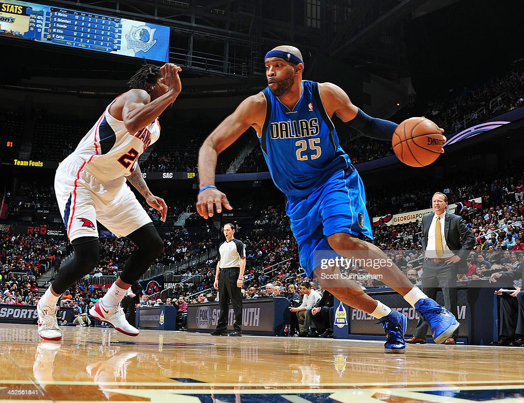 <a gi-track='captionPersonalityLinkClicked' href=/galleries/search?phrase=Vince+Carter&family=editorial&specificpeople=201488 ng-click='$event.stopPropagation()'>Vince Carter</a> #25 of the Dallas Mavericks handles the ball against the Atlanta Hawks on November 29, 2013 at Philips Arena in Atlanta, Georgia.