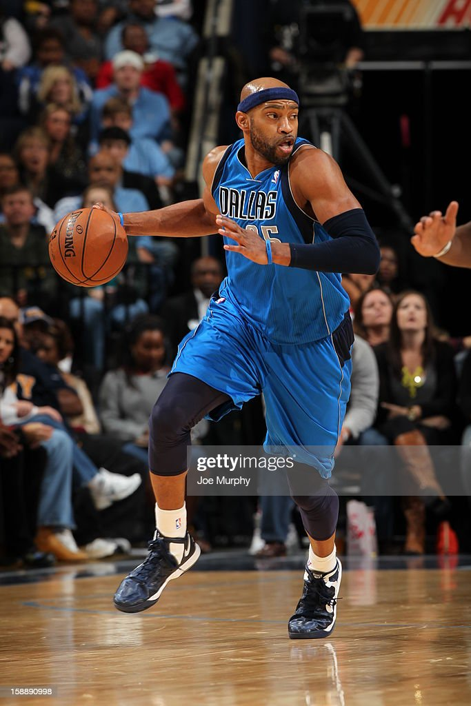 <a gi-track='captionPersonalityLinkClicked' href=/galleries/search?phrase=Vince+Carter&family=editorial&specificpeople=201488 ng-click='$event.stopPropagation()'>Vince Carter</a> #25 of the Dallas Mavericks handles the ball up-court against the Memphis Grizzlies on December 21, 2012 at FedExForum in Memphis, Tennessee.