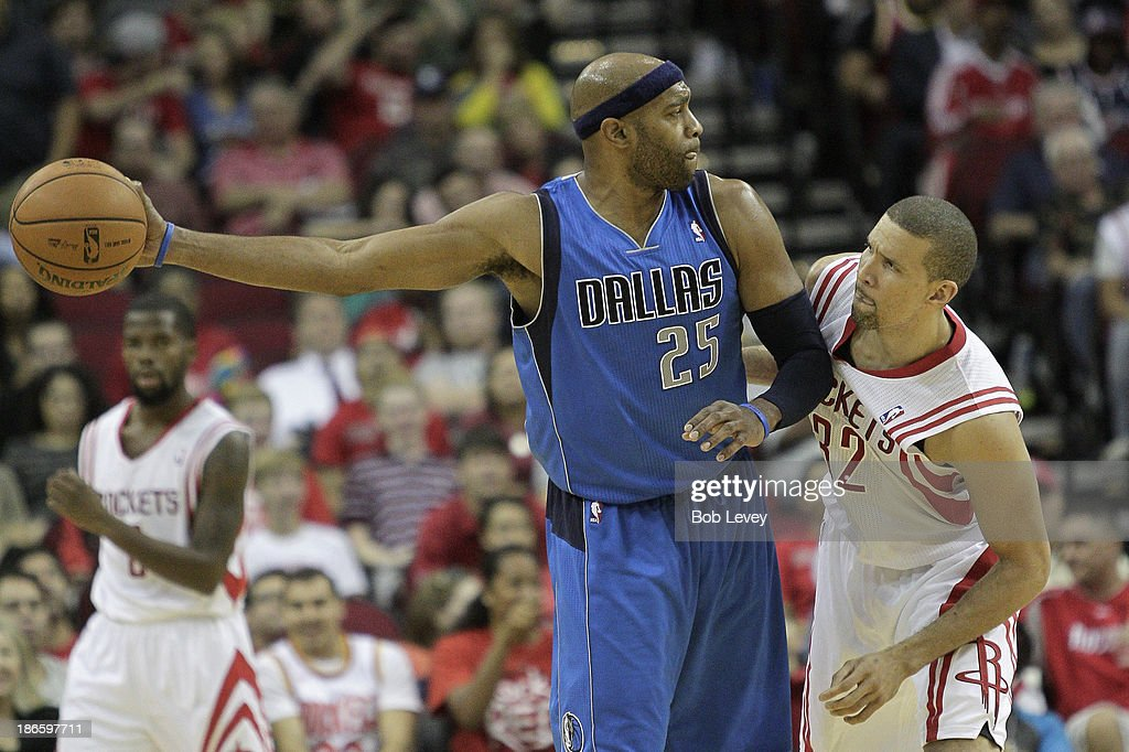 <a gi-track='captionPersonalityLinkClicked' href=/galleries/search?phrase=Vince+Carter&family=editorial&specificpeople=201488 ng-click='$event.stopPropagation()'>Vince Carter</a> #25 of the Dallas Mavericks keeps the ball away from <a gi-track='captionPersonalityLinkClicked' href=/galleries/search?phrase=Francisco+Garcia&family=editorial&specificpeople=198958 ng-click='$event.stopPropagation()'>Francisco Garcia</a> #32 of the Houston Rockets at Toyota Center on November 1, 2013 in Houston, Texas.