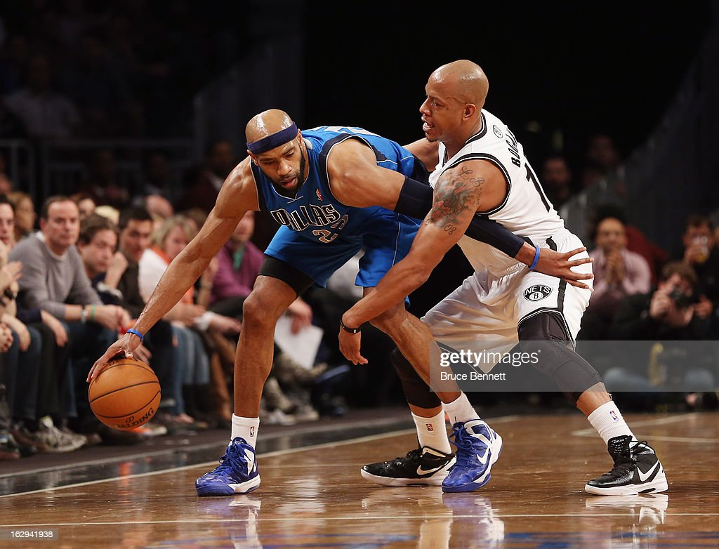 Vince Carter #25 of the Dallas Mavericks keeps the ball away from Keith Bogans #10 of the Brooklyn Nets at the Barclays Center on March 1, 2013 in New York City.