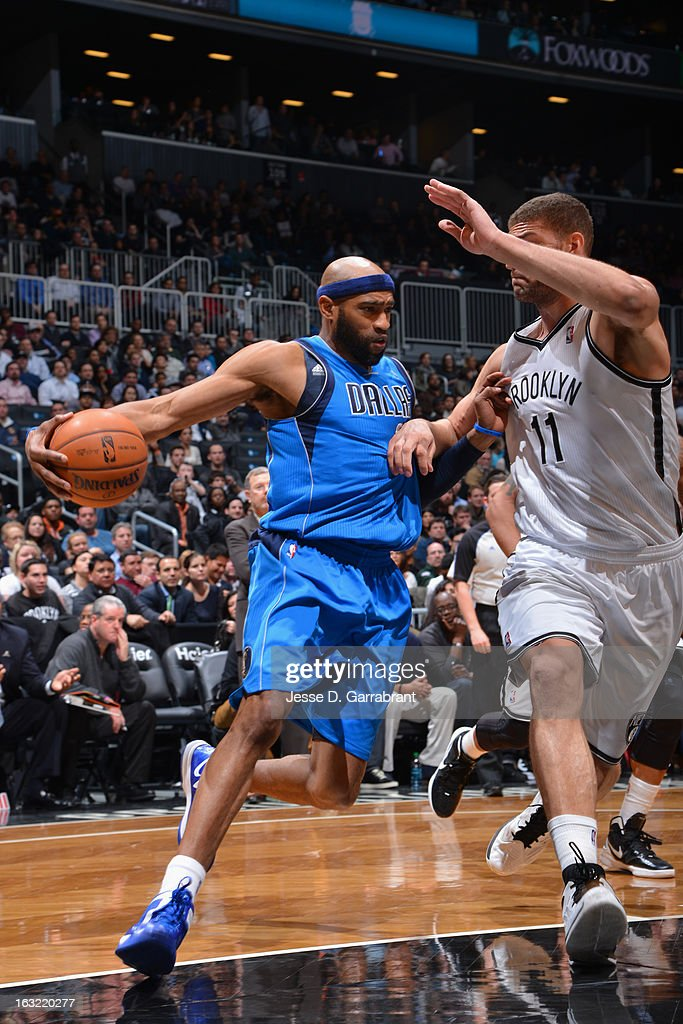 <a gi-track='captionPersonalityLinkClicked' href=/galleries/search?phrase=Vince+Carter&family=editorial&specificpeople=201488 ng-click='$event.stopPropagation()'>Vince Carter</a> #25 of the Dallas Mavericks looks to pass the ball against the Brooklyn Nets on March 1, 2013 at the Barclays Center in Brooklyn, New York.