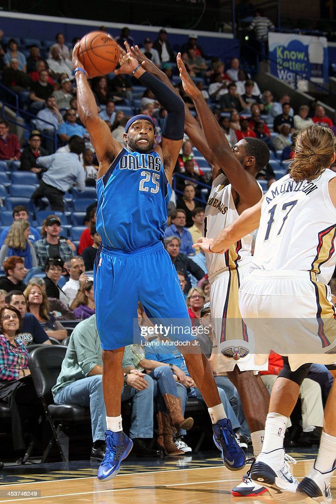 <a gi-track='captionPersonalityLinkClicked' href=/galleries/search?phrase=Vince+Carter&family=editorial&specificpeople=201488 ng-click='$event.stopPropagation()'>Vince Carter</a> #25 of the Dallas Mavericks makes a pass against the New Orleans Pelicans on December 4, 2013 at the New Orleans Arena in New Orleans, Louisiana.