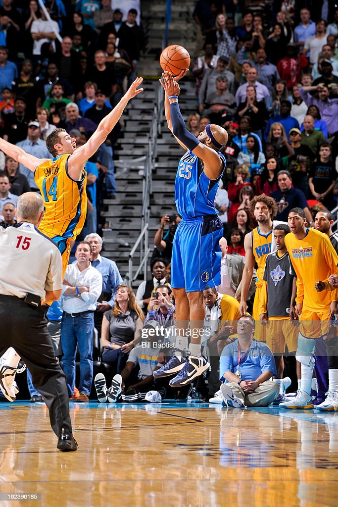 <a gi-track='captionPersonalityLinkClicked' href=/galleries/search?phrase=Vince+Carter&family=editorial&specificpeople=201488 ng-click='$event.stopPropagation()'>Vince Carter</a> #25 of the Dallas Mavericks makes a three-pointer against Jason Smith #14 of the New Orleans Hornets on February 22, 2013 at the New Orleans Arena in New Orleans, Louisiana.