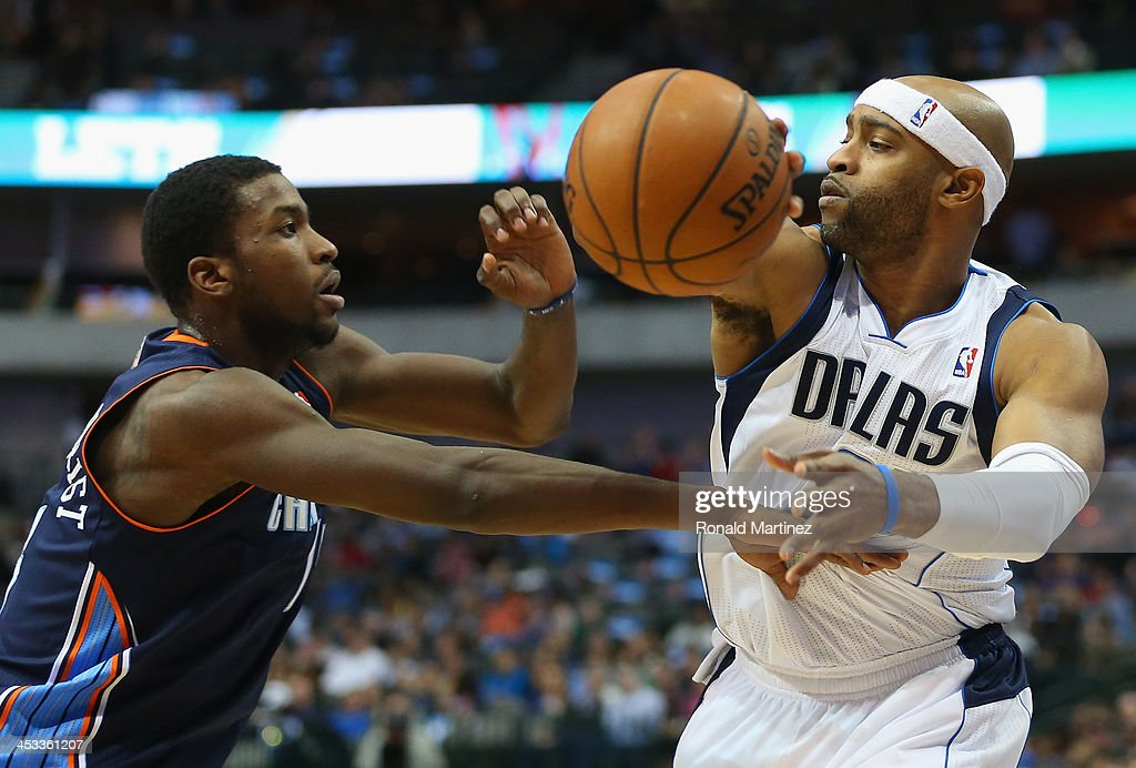 Vince Carter #25 of the Dallas Mavericks passes the ball against Michael Kidd-Gilchrist #14 of the Charlotte Bobcats at American Airlines Center on December 3, 2013 in Dallas, Texas.