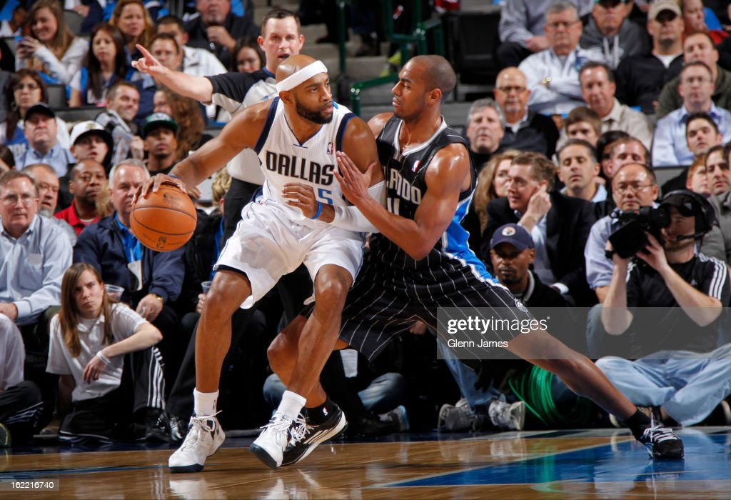 Vince Carter #25 of the Dallas Mavericks posts up against Arron Afflalo #4 of the Orlando Magic on February 20, 2013 at the American Airlines Center in Dallas, Texas.