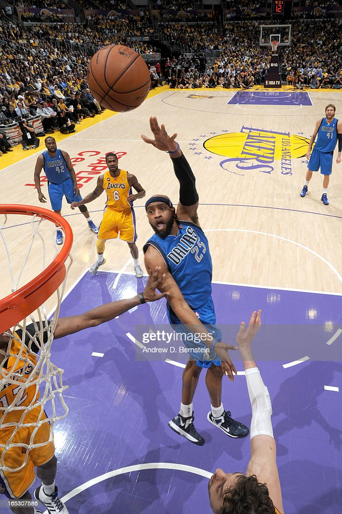 Vince Carter #25 of the Dallas Mavericks puts up a shot against Pau Gasol #16 of the Los Angeles Lakers at Staples Center on April 2, 2013 in Los Angeles, California.