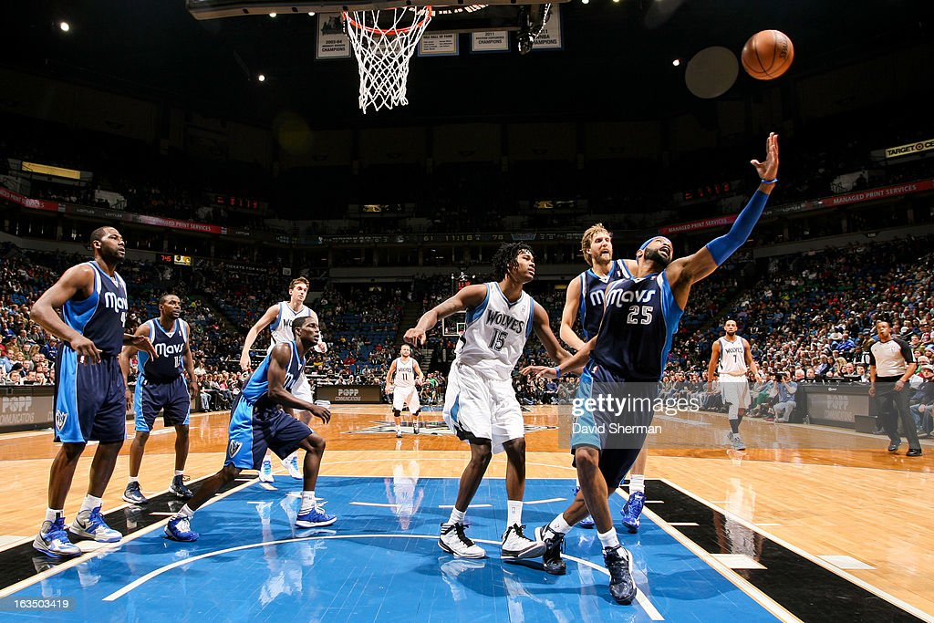 <a gi-track='captionPersonalityLinkClicked' href=/galleries/search?phrase=Vince+Carter&family=editorial&specificpeople=201488 ng-click='$event.stopPropagation()'>Vince Carter</a> #25 of the Dallas Mavericks reaches for a rebound against the Minnesota Timberwolves on March 10, 2013 at Target Center in Minneapolis, Minnesota.