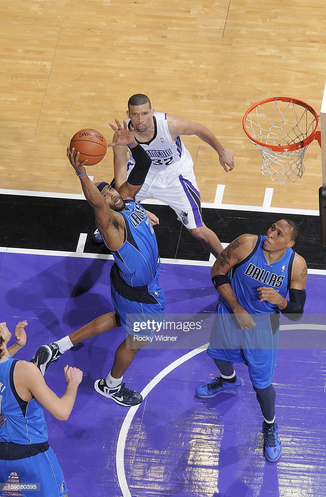 Vince Carter #25 of the Dallas Mavericks rebounds against the Sacramento Kings on January 10, 2013 at Sleep Train Arena in Sacramento, California.