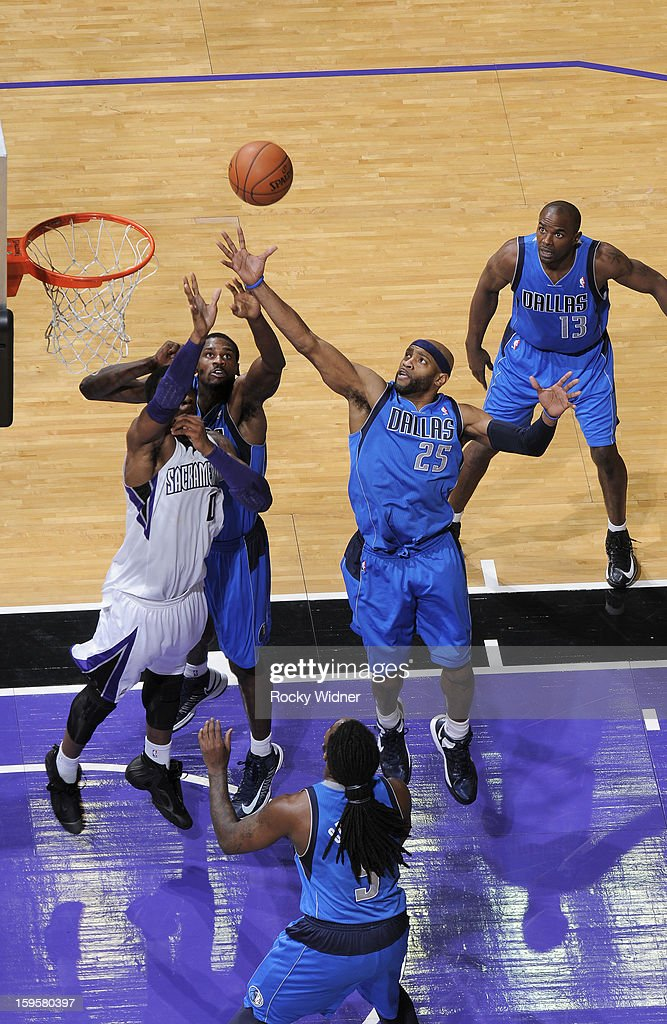 <a gi-track='captionPersonalityLinkClicked' href=/galleries/search?phrase=Vince+Carter&family=editorial&specificpeople=201488 ng-click='$event.stopPropagation()'>Vince Carter</a> #25 of the Dallas Mavericks rebounds against Thomas Robinson #0 of the Sacramento Kings on January 10, 2013 at Sleep Train Arena in Sacramento, California.