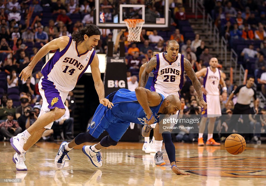 <a gi-track='captionPersonalityLinkClicked' href=/galleries/search?phrase=Vince+Carter&family=editorial&specificpeople=201488 ng-click='$event.stopPropagation()'>Vince Carter</a> #25 of the Dallas Mavericks scrambles for a loose ball with <a gi-track='captionPersonalityLinkClicked' href=/galleries/search?phrase=Luis+Scola&family=editorial&specificpeople=2464749 ng-click='$event.stopPropagation()'>Luis Scola</a> #14 and Shannon Brown #26 of the Phoenix Suns during the NBA game at US Airways Center on December 6, 2012 in Phoenix, Arizona. The Mavericks defeated the Suns 97-94.