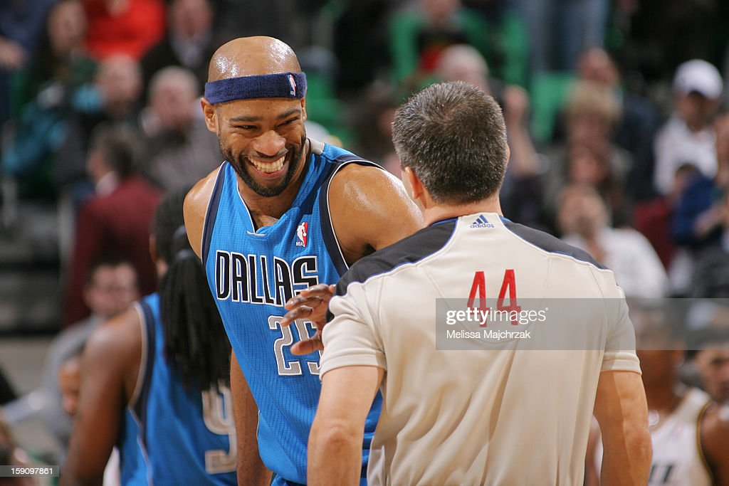 Vince Carter #25 of the Dallas Mavericks shares a laugh with the referee Eli Roe during a break in play against the Utah Jazz at Energy Solutions Arena on January 7, 2013 in Salt Lake City, Utah.