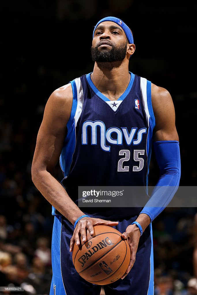<a gi-track='captionPersonalityLinkClicked' href=/galleries/search?phrase=Vince+Carter&family=editorial&specificpeople=201488 ng-click='$event.stopPropagation()'>Vince Carter</a> #25 of the Dallas Mavericks shoots a free-throw against the Minnesota Timberwolves on March 10, 2013 at Target Center in Minneapolis, Minnesota.