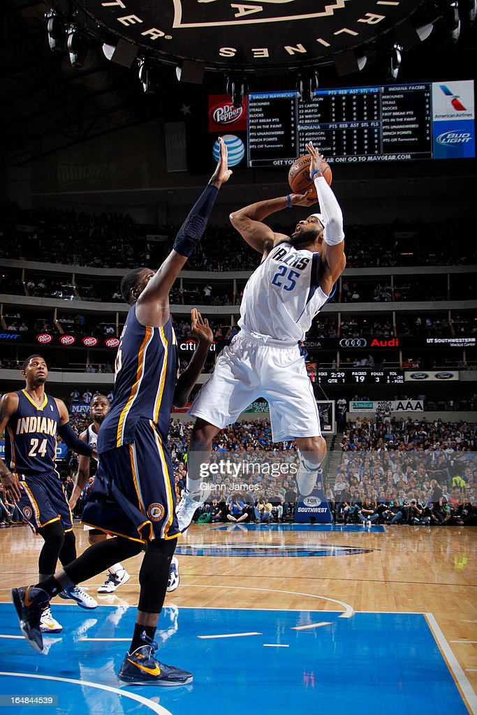 Vince Carter #25 of the Dallas Mavericks shoots a jumper against Roy Hibbert #55 of the Indiana Pacers on March 28, 2013 at the American Airlines Center in Dallas, Texas.