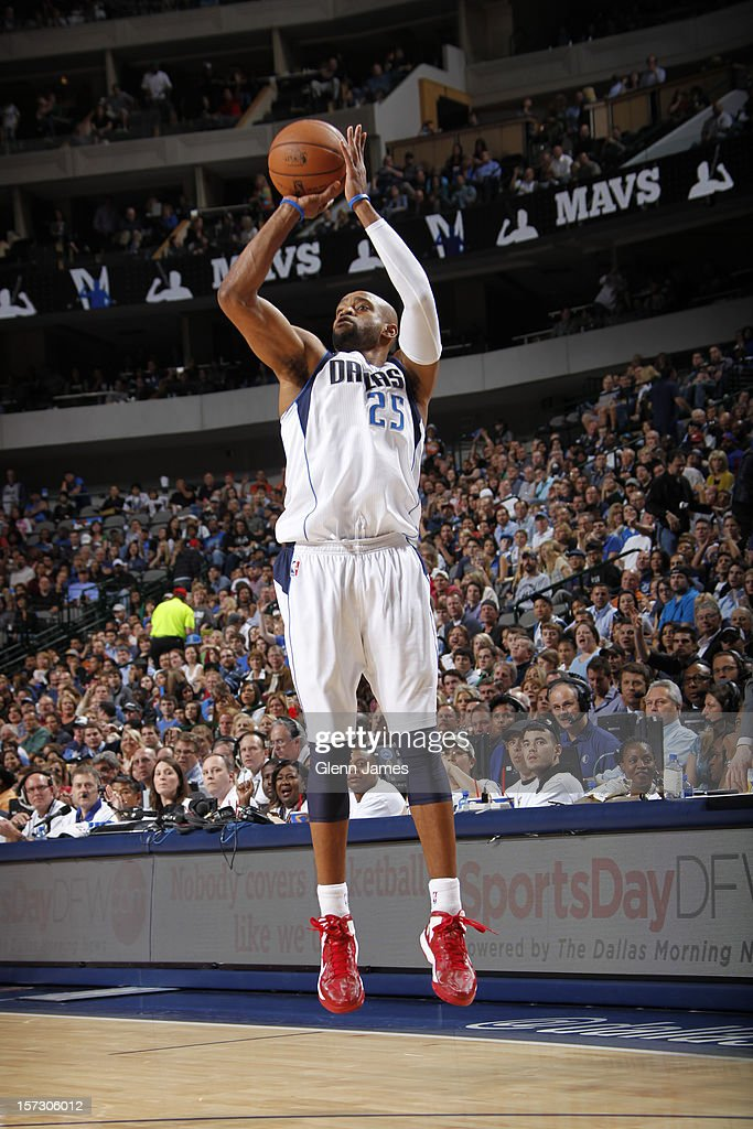 <a gi-track='captionPersonalityLinkClicked' href=/galleries/search?phrase=Vince+Carter&family=editorial&specificpeople=201488 ng-click='$event.stopPropagation()'>Vince Carter</a> #25 of the Dallas Mavericks shoots a jumper against the Detroit Pistons on December 1, 2012 at the American Airlines Center in Dallas, Texas.