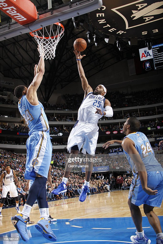 Vince Carter #25 of the Dallas Mavericks shoots a layup against JaVale McGee #34 of the Denver Nuggets on December 28, 2012 at the American Airlines Center in Dallas, Texas.