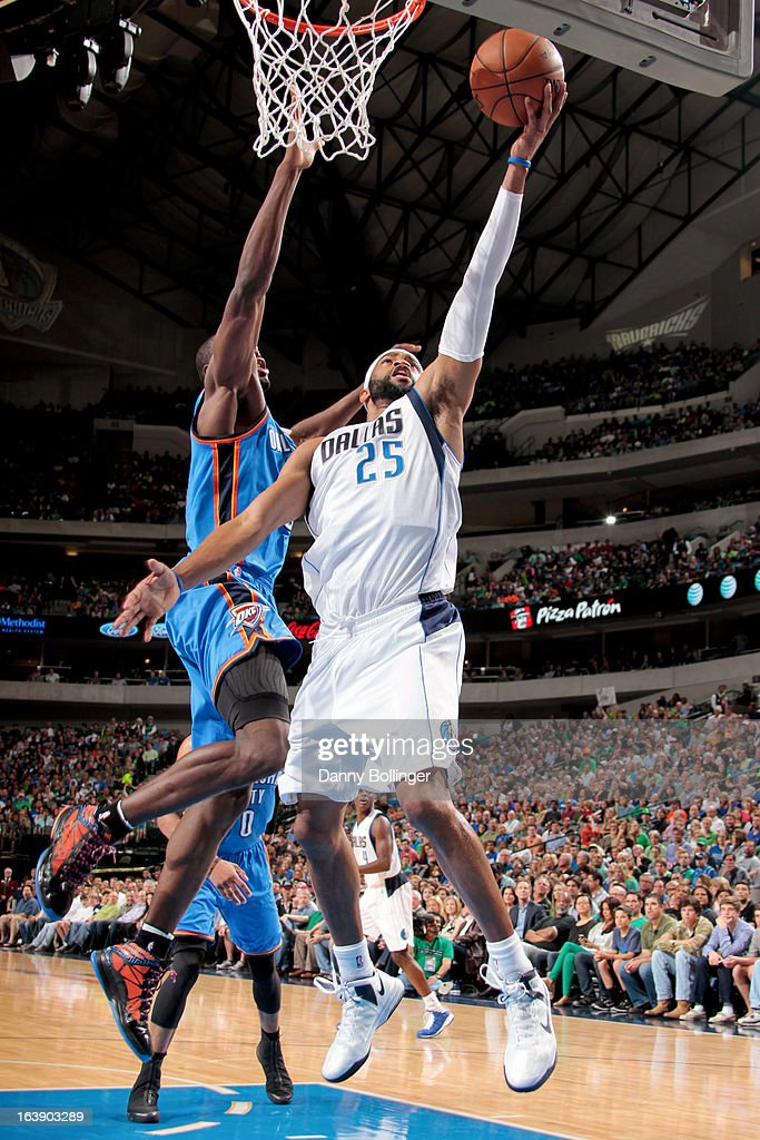 Vince Carter #25 of the Dallas Mavericks shoots a layup against Serge Ibaka #9 of the Oklahoma City Thunder on March 17, 2013 at the American Airlines Center in Dallas, Texas.